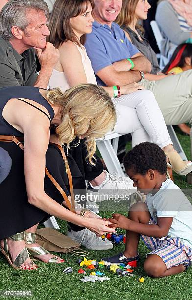 Charlize Theron Sean Penn and Jackson Theron attend the generationOn West Coast Block Party on April 18 2015 in Beverly Hills California