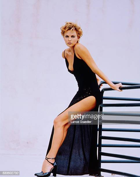 Charlize Theron Wearing a Black Evening Gown