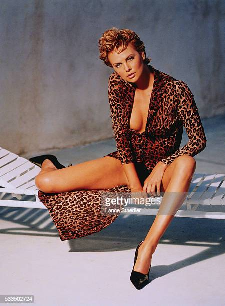 Charlize Theron Wearing a Leopard Print Dress