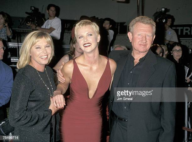 Charlize Theron with her mother and stepfather at the Mann Village Theatre in Westwood California