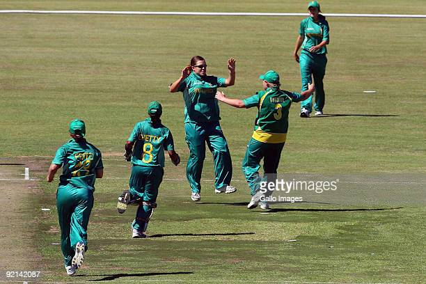 Charlize van der Westhuizen from South Africa celebrates taking a catch to dismiss Deandra Dottin from West Indies off her own bowling during the...