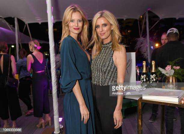 Charlott Cordes and Nicky Hilton Rothschild attend L'Eden by PerrierJouët on December 6 2018 in Miami Beach Florida