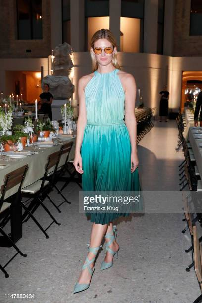 Charlott Cordes wearing Max Mara with table setting by Meissen porcelain during the Max Mara Resort 2020 Fashion Show at Neues Museum on June 3 2019...