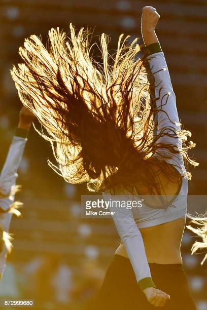 Charlotte 49ers dance team member performs during a stoppage in play of the 49ers' football game against the Middle Tennessee Blue Raiders at Jerry...