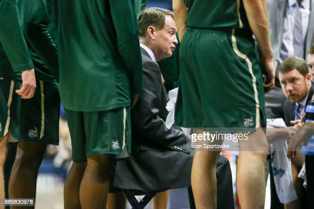 Charlotte 49ers head coach Mark Price talks to his boys during a timeout in the second half of the college basketball game between UNC Charlotte and...
