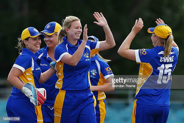 Charlotte Anneveld of the Meteors celebrates with team mates after claiming the wicket of Elyse Villani of the Spirit during the WNCL match between...