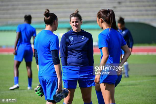 Charlotte Bilbault of Paris FC chats with Celine Deville of Paris FC and Ami Otaki of Paris FC during a training session on September 1 2017 in...