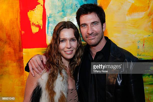 Charlotte Bjorlin Delia and actor Dylan McDermott pose at the AWOL Exhibit Opening Night Gala on May 8 2010 in Venice California