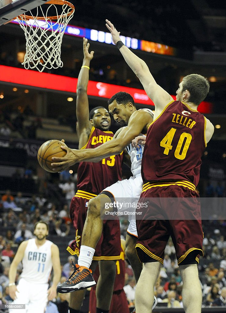 Charlotte Bobcats' Gerald Henderson (9) passes the ball between Cleveland Cavaliers' Tristan Thompson (13) and Tyler Zeller (40) during the first half at Time Warner Cable Arena in Charlotte, North Carolina, Wednesday, April 17, 2013.