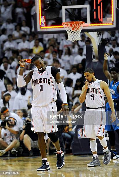 Charlotte Bobcats' Gerald Wallace and teammate DJ Augustin walk off the court after their 9086 loss to the Orlando Magic in Game 3 of the NBA Eastern...