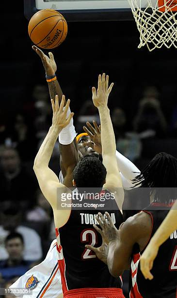 Charlotte Bobcats' Gerald Wallace drives past Toronto Raptors' Hedo Turkoglu to the basket in the first half of play at Time Warner Cable Arena in...