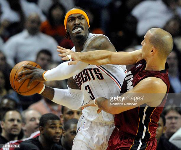 Charlotte Bobcats' Gerald Wallace gets pressured by Miami Heat's Carlos Arroyo during the second half at the Time Warner Cable Arena in Charlotte...