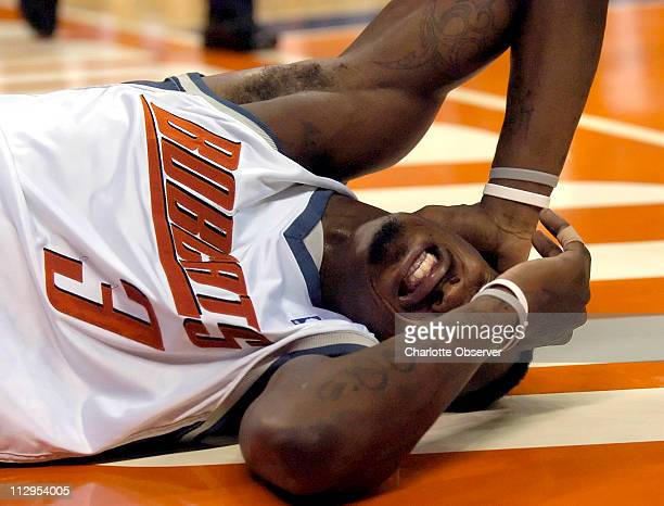 Charlotte Bobcats' Gerald Wallace grimaces after landing hard during a foul by Indiana Pacers' Danny Granger during the second quarter at the...