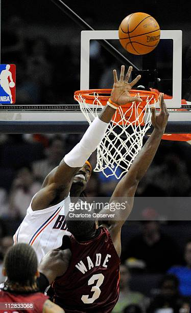 Charlotte Bobcats' Gerald Wallace tries to block the layup of Miami Heat's Dwyane Wade during the first half at the Time Warner Cable Arena in...