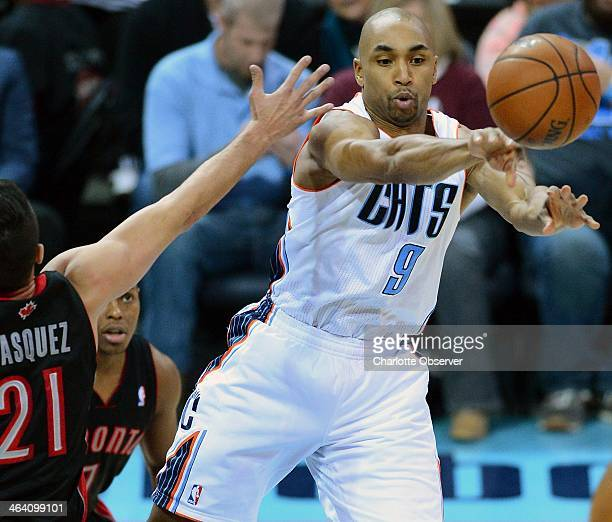 Charlotte Bobcats guard Gerald Henderson passes the ball out to a teammate as Toronto Raptors guard Greivis Vasquez applies defensive pressure during...