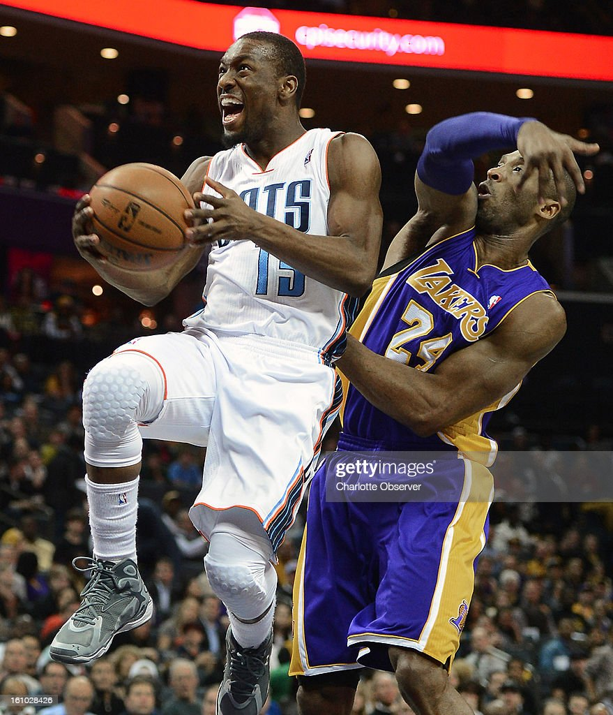 Charlotte Bobcats guard Kemba Walker (15) drives to the basket for two-points as Los Angeles Lakers guard Kobe Bryant (24) tries to apply defensive pressure from behind during first-half action at Time Warner Cable Arena in Charlotte, North Carolina, Friday, February 8, 2013.