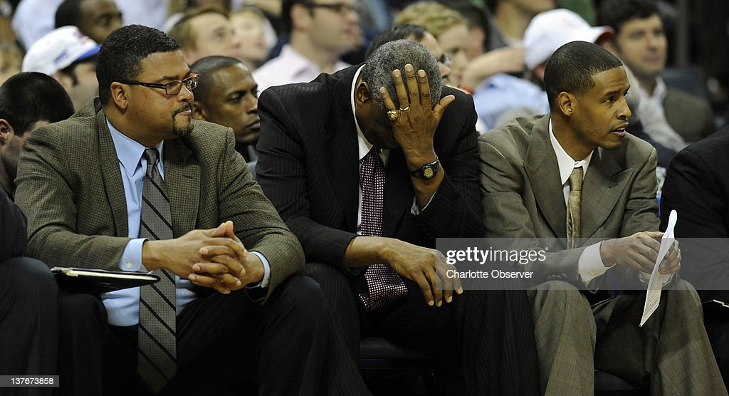 Charlotte Bobcats head coach Paul Silas, middle, rubs his forehead as assistant coaches Ralph Lewis, left, and Stephen Silas, right, look on during the second half against the New York Knicks at Time Warner Cable Arena in Charlotte, North Carolina, on Tuesday, January 24, 2012. New York rolled, 111-78.