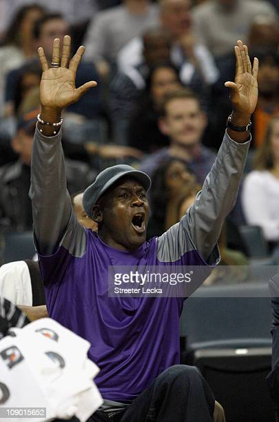 Charlotte Bobcats owner Michael Jordan reacts to a call while sitting on the bench during their game against the New Jersey Nets at Time Warner Cable...