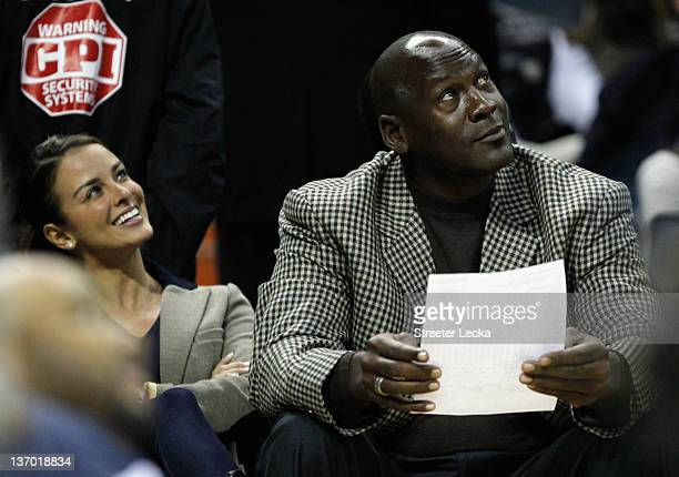 Charlotte Bobcats owner Michael Jordan sits beside fiance Yvette Prieto during the Golden State Warriors versus Charlotte Bobcats game at Time Warner...