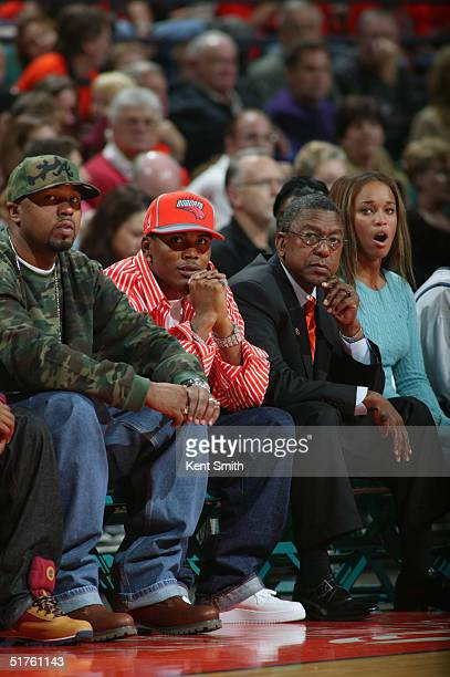 Charlotte Bobcats owner Robert L Johnson and recent minority owner and entertainer Nelly watch as the team faces the Washington Wizards November 4...