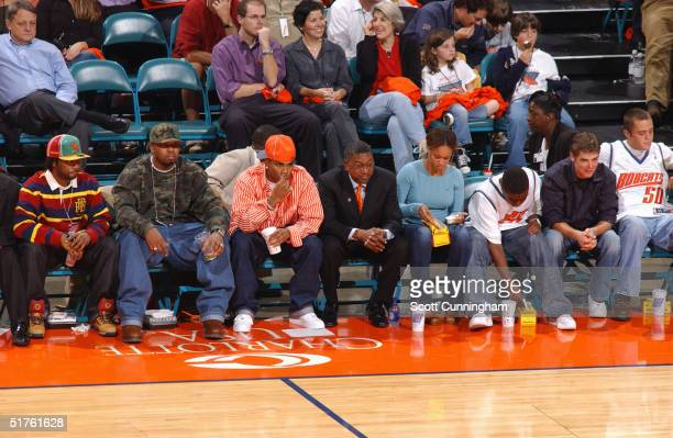 Charlotte Bobcats team owner Robert L. Johnson sits with minority owner Nelly and watches the team play the Washington Wizards November 4, 2004 at...