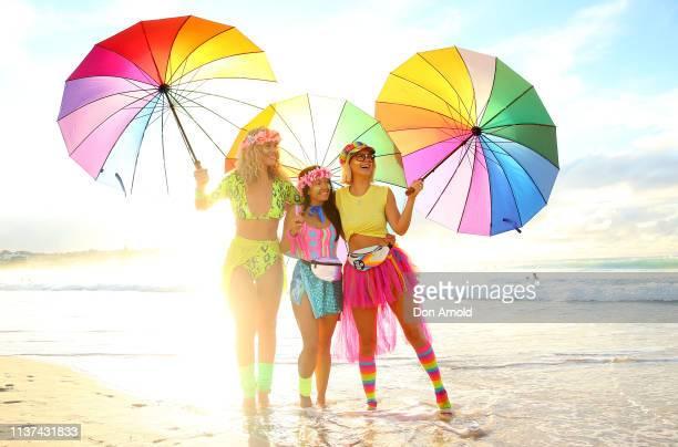 Charlotte Bodell Jodi Hooker and Liv Phyland pose on Bondi Beach shoreline on March 22 2019 in Sydney Australia Surfers gather to celebrate five...