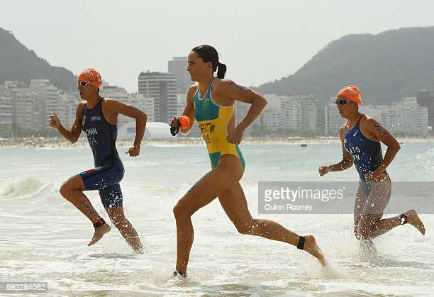 Charlotte Bonin of Italy Emma Moffatt of Australia and Yuka Sato of Japan leave the water during the Women's Triathlon on Day 15 of the Rio 2016...
