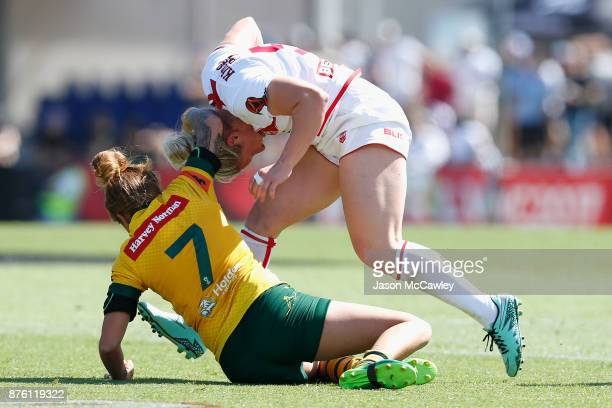 Charlotte Booth of England is tackled by Caitlin Moran of Australia during the 2017 Women's Rugby League World Cup match between Australia and...