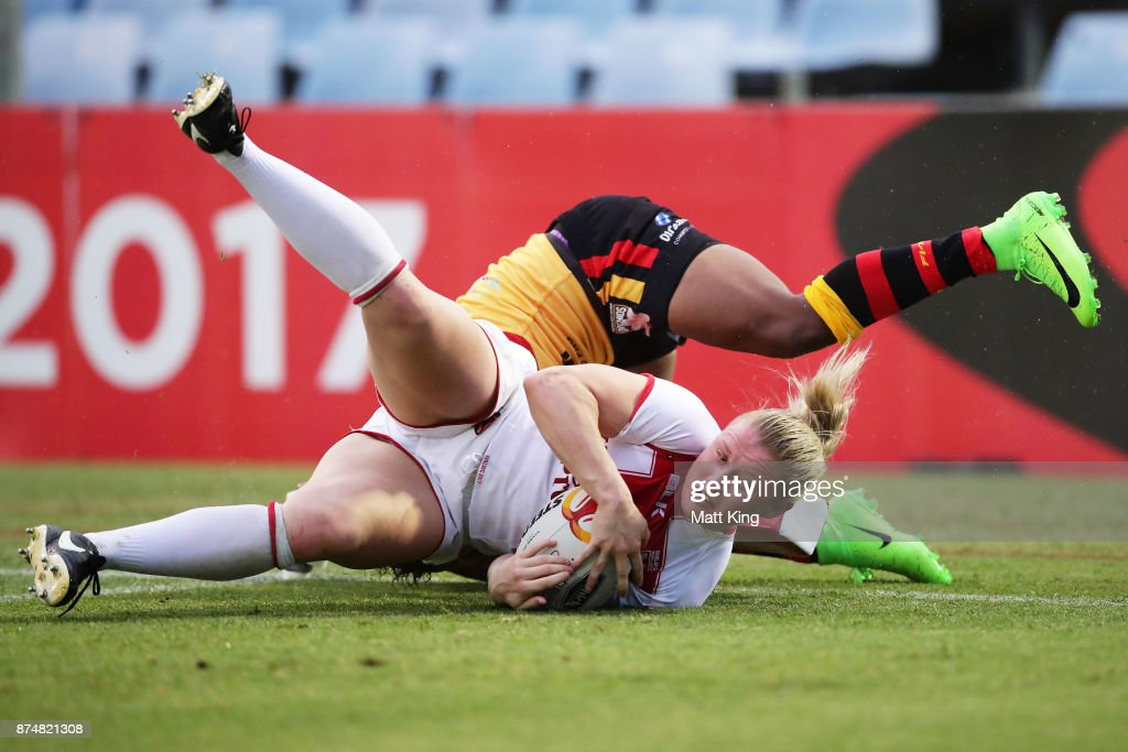 Charlotte Booth of England scores a try during the 2017 Women's Rugby League World Cup match between England and Papua New Guinea at Southern Cross Group Stadium on November 16, 2017 in Sydney, Australia.