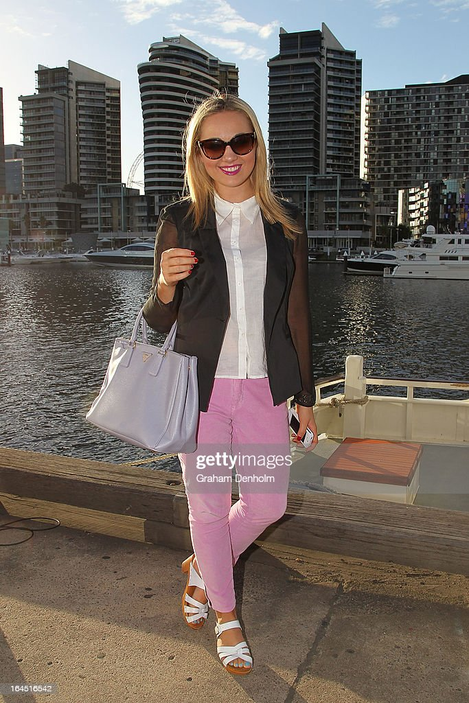 Charlotte Brock wears sunglasses by Prada, a blazer by Kookai, shirt and pants by Gorman, shoes by Windsor Smith and handbag by Prada on day seven at L'Oreal Melbourne Fashion Festival on March 24, 2013 in Melbourne, Australia.