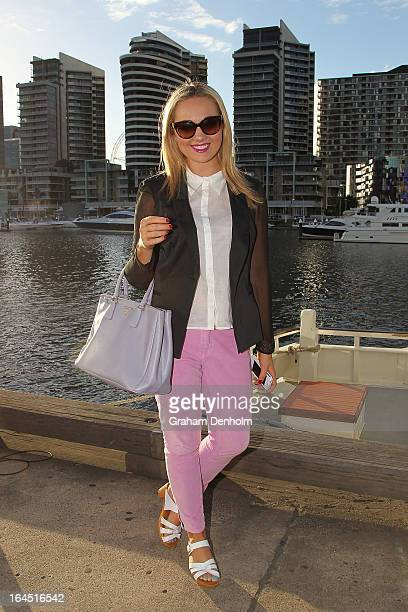 Charlotte Brock wears sunglasses by Prada a blazer by Kookai shirt and pants by Gorman shoes by Windsor Smith and handbag by Prada on day seven at...