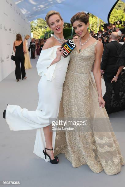 Charlotte Carrol and Saba Yussoufl arrive at the amfAR Gala Cannes 2018 at Hotel du CapEdenRoc on May 17 2018 in Cap d'Antibes France