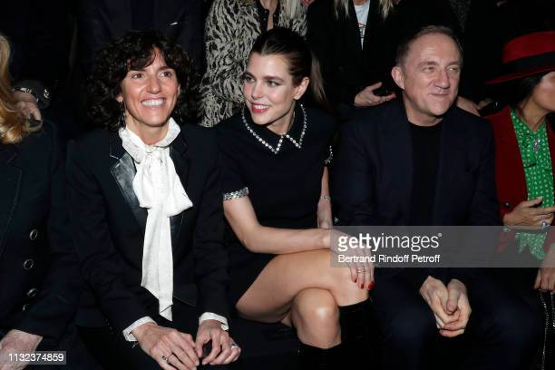 Charlotte Casiraghi and CEO of Kering Group FrancoisHenri Pinault and his wife actress Salma Hayek attend the Saint Laurent show as part of the Paris...