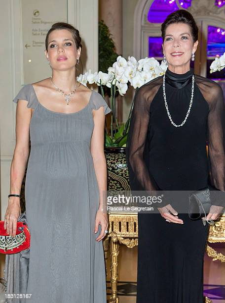 Charlotte Casiraghi and her mother Princess Caroline of Hanover pose as they arrive to attend the AMADE MONDIALE association Gala Dinner at Hotel...