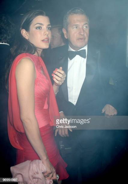 Charlotte Casiraghi and Mario Testino are seen before smoke alarms go off as they attend the Love Ball London at the Roundhouse on February 23, 2010...