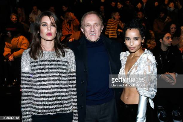 Charlotte Casiraghi CEO of Kering Group FrancoisHenri Pinault and Zoe Kravitz attend the Saint Laurent show as part of the Paris Fashion Week...