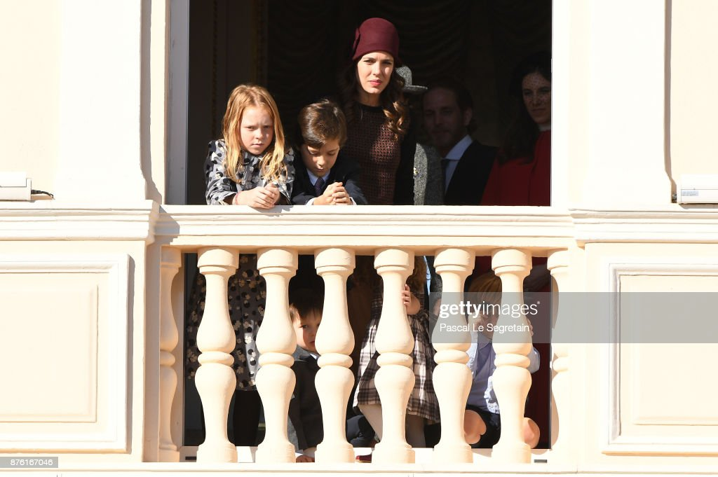 Charlotte Casiraghi (C) greets the crowd from the palace's balcony during the Monaco National Day Celebrations on November 19, 2017 in Monaco, Monaco.