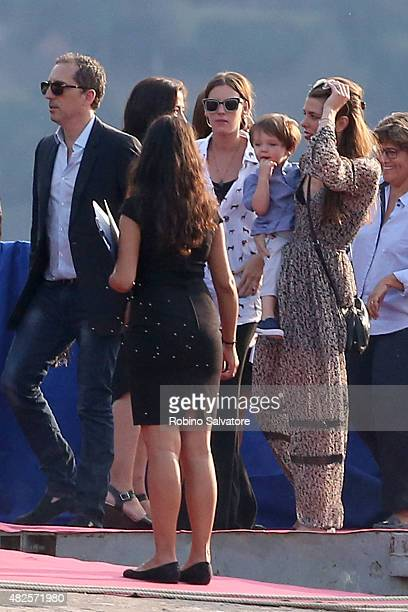 Charlotte Casiraghi Raphael Elmaleh and Gad Elmaleh arrive at the Pierre Casiraghi and Beatrice Borromeo wedding welcome party on July 31 2015 in...