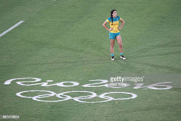 Charlotte Caslick Australia watches on during the Women's Gold Medal Final Rugby Sevens match between Australia and New Zealand on August 8 2016 in...