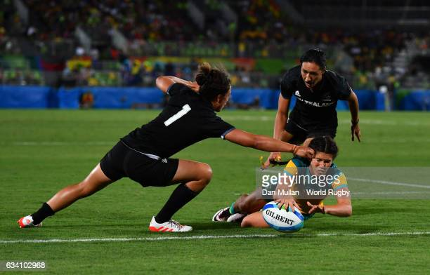 Charlotte Caslick of Australia dives over for a try during the Women's Rugby Sevens Gold Medal match between Australia and New Zealand on day 3 of...