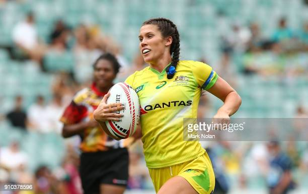 Charlotte Caslick of Australia heads to the try line to score in the womens pool match between Australia and Papua New Guinea during day one of the...