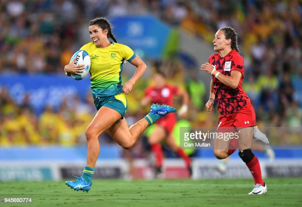 Charlotte Caslick of Australia is chases down by Jasmine Joyce of Wales during the Rugby Sevens Women's Pool B match between Australia and Wales on...