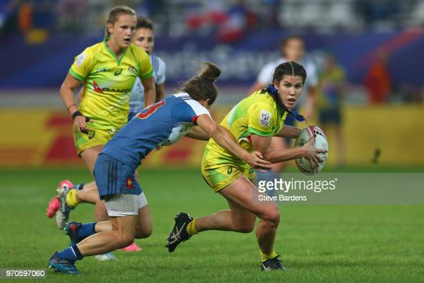 Charlotte Caslick of Australia is tackled by Chloe Pelle of France during the Women's Cup semi final between Australia and France during the HSBC...