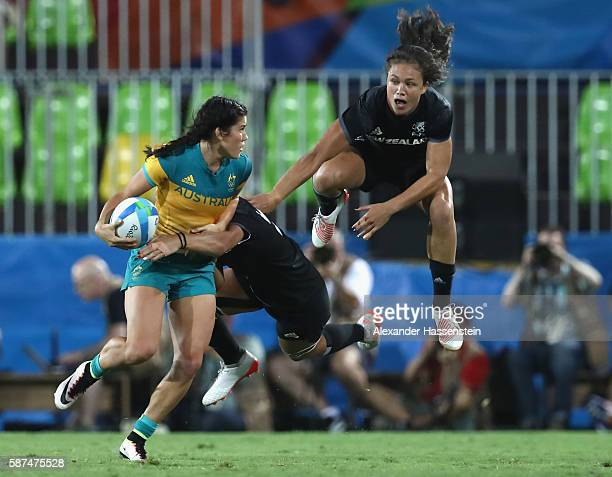 Charlotte Caslick of Australia is tackled by Shakira Baker of New Zealand during the Women's Gold Medal Rugby Sevens match between Australia and New...