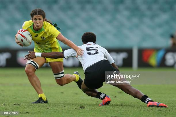 Charlotte Caslick of Australia is tackled by Talica Vodo of Fiji during the pool match between Australia and Fiji in the 2017 HSBC Sydney Sevens at...