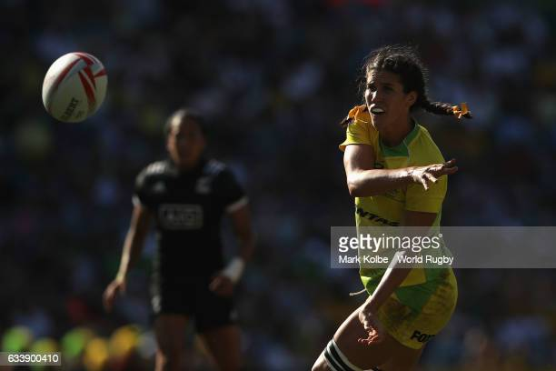 Charlotte Caslick of Australia passes during the womens bronze cup match in the 2017 HSBC Sydney Sevens at Allianz Stadium on February 4 2017 in...