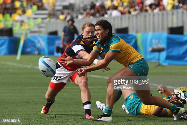Charlotte Caslick of Australia passes the ball under pressure from Alev Kelter of the United States during the Women's Pool A rugby match on Day 2 of...