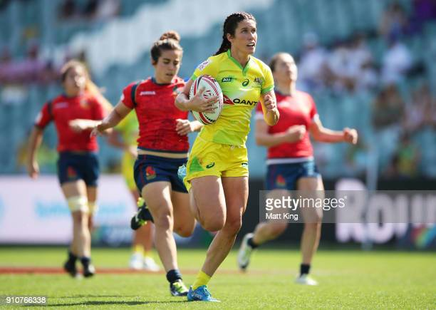 Charlotte Caslick of Australia runs away to score a try during day two of the 2018 Sydney Sevens at Allianz Stadium on January 27 2018 in Sydney...