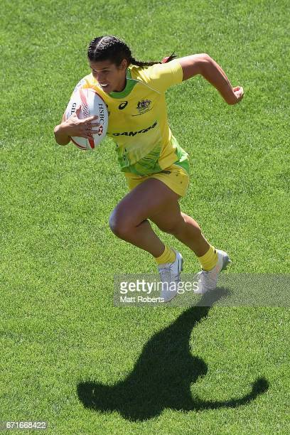 Charlotte Caslick of Australia runs with the ball during the HSBC World Rugby Women's Sevens Series 2016/17 Kitakyushu quarter final between...