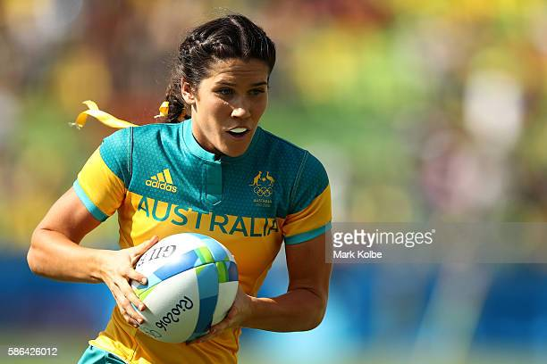 Charlotte Caslick of Australia runs with the ball during the Women's Pool A rugby match between Ausutralia and Colombia on Day 1 of the Rio 2016...